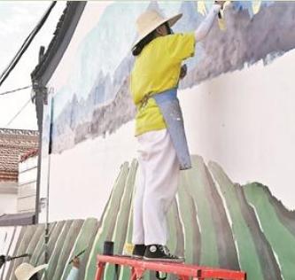 美术学院实践团开展墙绘工作 一笔一划描出闽宁情